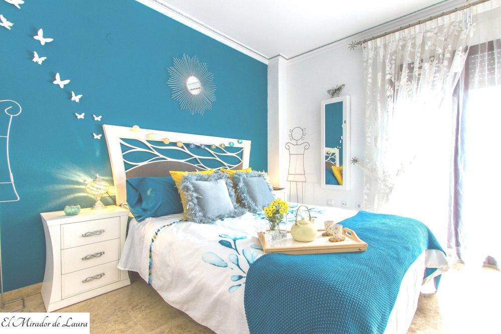 Dormitorio principal azul y blanco